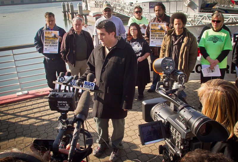 Mike King of Occupy Oakland speaks at a press conference on plans about shutting down the Port of Oakland in Oakland, Calif., on Friday, December 9, 2011.