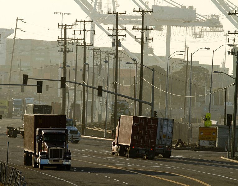 Trucks move containers in and out of the Port of Oakland in Oakland, Calif., on Friday, December 9, 2011. Story about how Occupy Oaklland plans to shut down the port on December 12th.