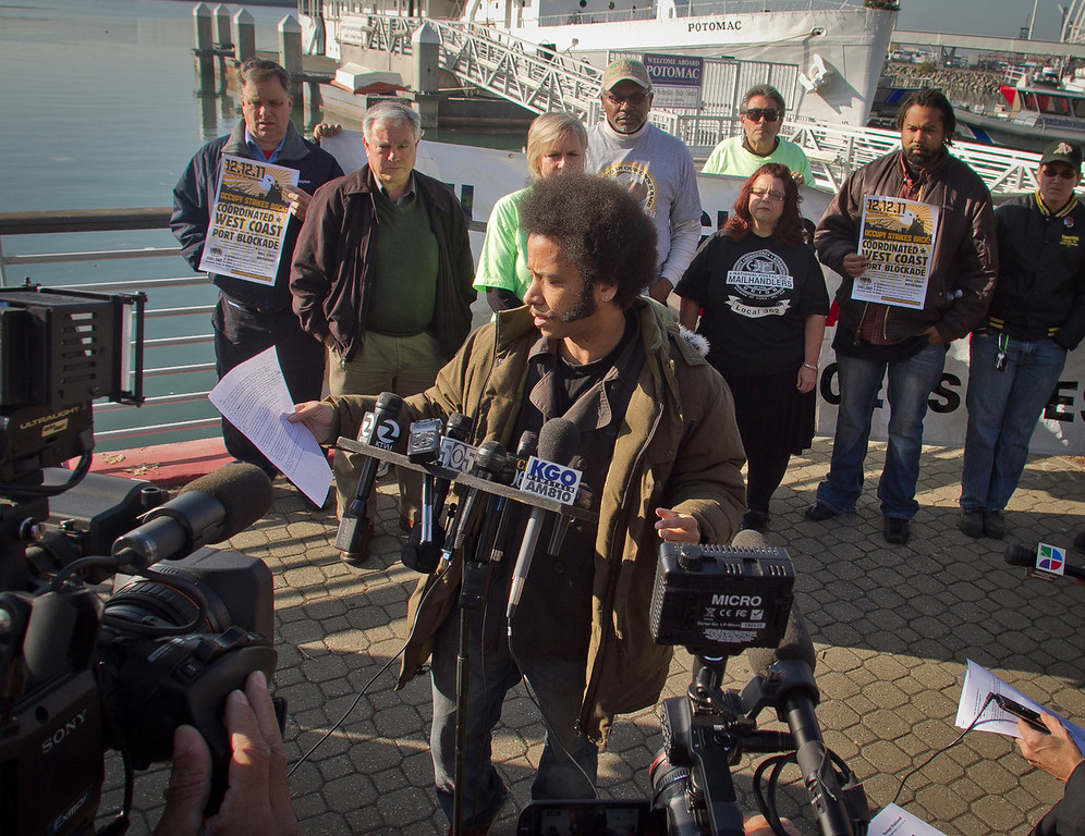 Boots Riley reads a statement at a press conference organized by Occupy Oakland on plans about shutting down the Port of Oakland in Oakland, Calif., on Friday, December 9, 2011.