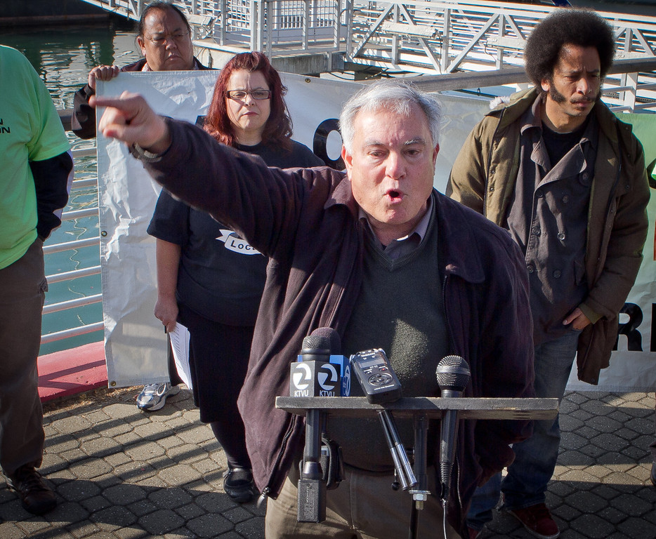 Labor activist Steve Zeltzer speaks at a press conference organized by Occupy Oakland on plans about shutting down the Port of Oakland in Oakland, Calif., on Friday, December 9, 2011.