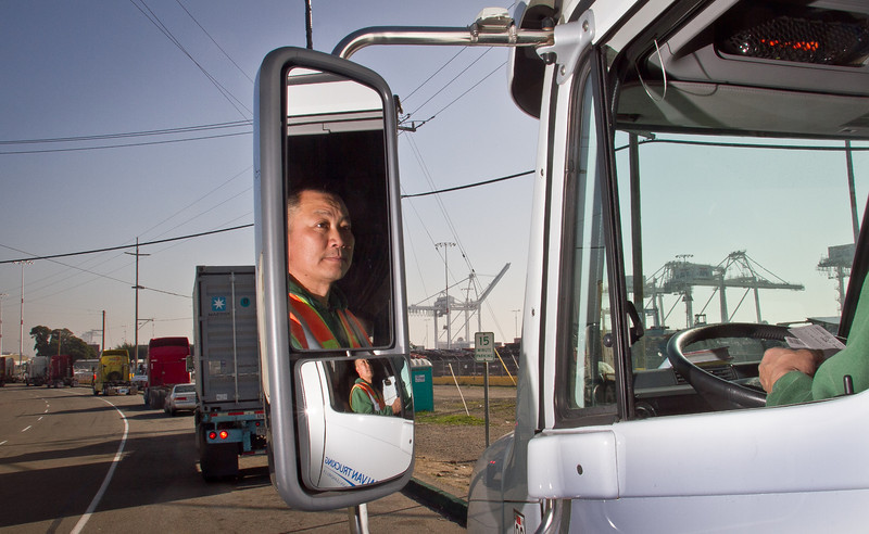 Truck driver Hai Ngo of San Leandro in his truck at the Port of Oakland in Oakland, Calif., on Friday, December 9, 2011. Story about how Occupy Oakland plans to shut down the Port of Oakland on December 12th.