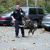 Newtown K-9 Baro tries to take a bite out of Officer Matthew Hayes. Along with Baro's handler, Officer Felicia Figol, the trio offered a demonstration of the dog's training during Passport. (Hicks photo)