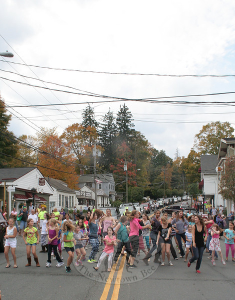 "Dancers from The Graceful Planet turned a small section of Church Hill Road into a performance space for a few minutes on Saturday, October 6, when they assembled and danced to ""Gangnam Style."" The dancers had a built-in audience, considering a few hundred people were in Sandy Hook Center that afternoon for the 2nd Annual Passport To Sandy Hook, a special event that encouraged people to walk around and explore the district while taking a chance on three prizes that had been created from donations by the businesses within the area. (Hicks photo)"