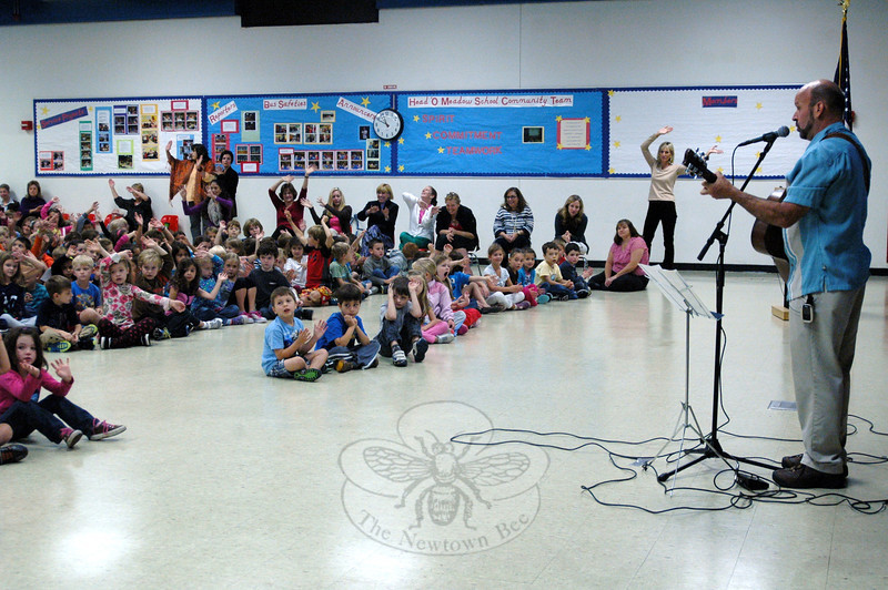 Singer/song writer Brian Chevalier performed Head O' Meadow's new school song for the first time before the whole school during on assembly on Tuesday, October 2. (Hallabeck photo)