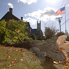 Winds this week pulled down one mature limb that grazed the side of the historic Didier home on Main Street near the flagpole. Scraping against windowpanes and shingles, the branch fell short of seriously damaging the house by inches. Trees and branches all over town came down in Wednesday's windstorm, causing sporadic power outages throughout the day.  (Bee Photo, Bobowick)