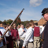 A St Rose of Lima sixth grader held a musket after Newtown resident and 2nd Connecticut Volunteer Heavy Artillery Regiment of Woodbury member Bob Graves gave a presentation on the Civil War. (Bee Photo, Hallabeck)