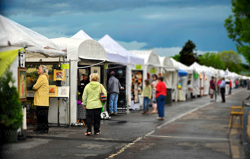 More than 100 juried artists set up tents along Lake Street in downtown Wayzata hoping to sell their work on a rainy, Spring weekend.  On Sunday, May 22, a quick break in the weather drew shoppers and visitors to the Lake Minnetonka event.