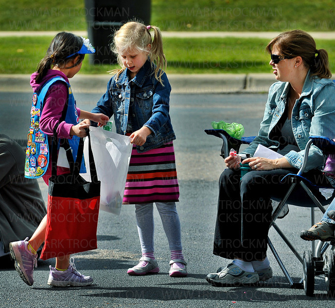 A Plymouth on Parade candy hand-out by Girl Scouts keeps Mya Rasmussen, five, busy while her mom, Christina, looks on Saturday, Sept. 24, 2011.  The parade starts at Plymouth Boulevard and 34th Avenue and runs down Plymouth Boulevard to 37th Ave., with post-parade family activities following the annual Autumn festival.