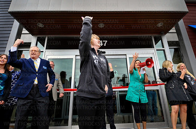 Kari Logan, center, and Muni and Wayzata VIP's continue to dance Thursday, April 28, in front of the new Muni just before the grand opening.  Wayzata Mayor Ken Wilcox is on the left.