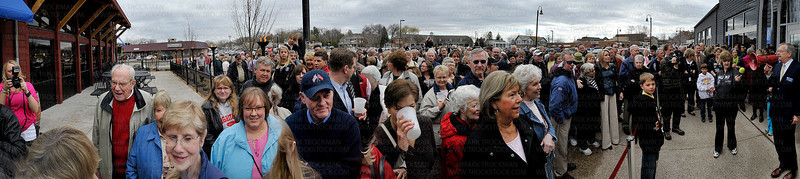 Wayzata Mayor Ken Wilcox (right) addresses a crowd of hundreds before the new Muni opened it's doors for the first time Thursday, April 28, in Wayzata.