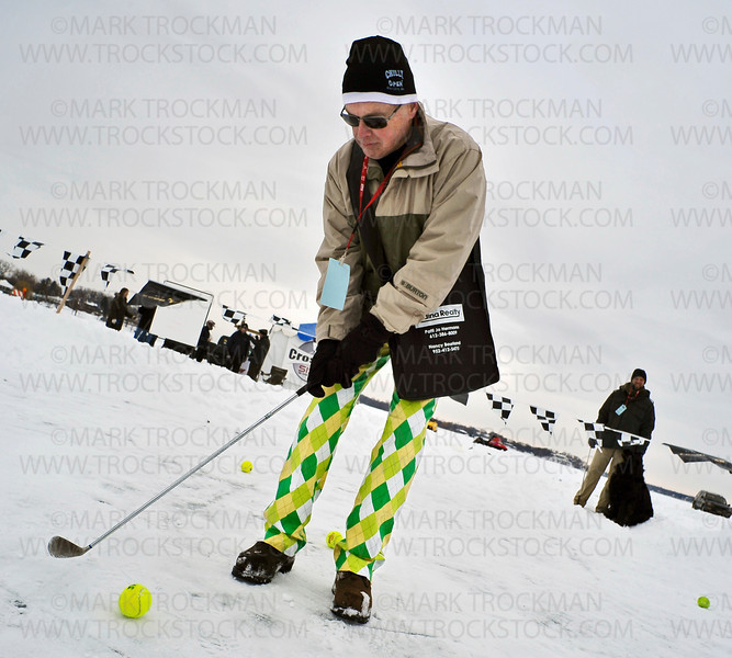 The pants make the man.  John Fitzpatrick, Wayzata, concentrates on his shot during the 27th annual Chilly Open Saturday, Feb.12, on Wayzata Bay on Lake Minnetonka.
