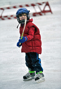 Five year old Bo Delich, Victoria, gets some quality skating time with his dad, Steve Delich and a couple friends at the public skating rink at Klapprich Park in Wayzata, Saturday, Jan. 7, 2012.