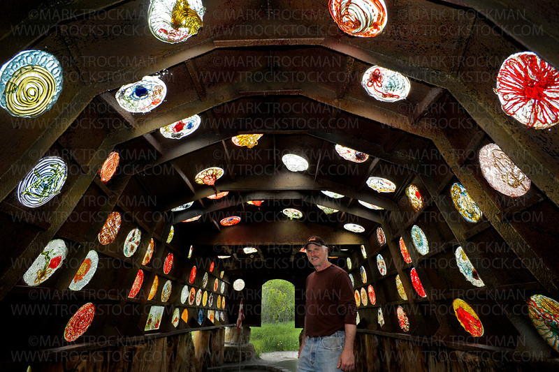 Big Stone Mini Golf & Sculpture Gardens owner Bruce Stillman inside Holey Ship, hole No. 7, Par 3, Tuesday, May 24, in Minnetrista.  The hole is one of the most popular spots inside Stillman's acres of strange and wonderful pieces of art and putt putt holes.