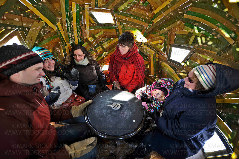 Controlling the spin and speed of the SitandSpinShanty, Jason Quick, from left, Nina Wawracz, Mali Mattson, Miriam Houg, two-year-old Leah Shipp and Grandma Shipp try to keep their breakfast down as the 'The Egg' picks up speed Saturday, Jan. 21, on Medicine Lake.