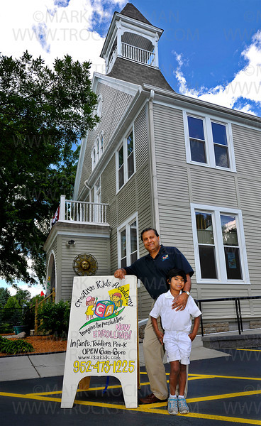 Creative Kids Academy owner and president Rjiv Garg and his six-year-old daughter, Meera Jain, outside the newly renovated Orono facility Friday, June 22, 2012.