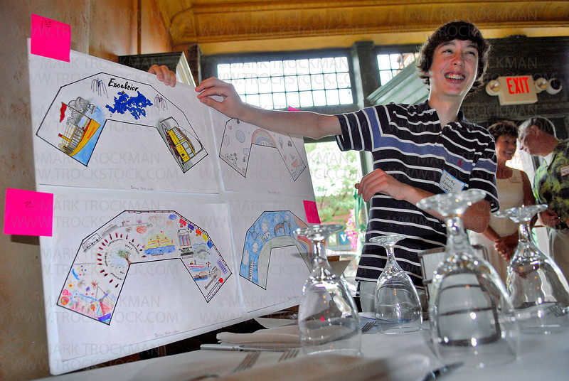 Timothy Zalusky, 14, of Chanhassen presents his winning rendering, upper left,  for the inside of the Excelsior Commons bandshell Thursday, July 27 at Biella in Excelsior.
