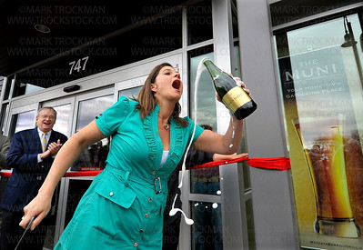 Sommelier Gina Holman drinks from the bottle of Champagne used to Christen the new Muni Thursday, April 28, in Wayzata.