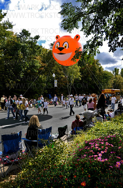 The Providence Academy contingent floats a big, orange, Lion-shaped balloon as they walk along the Plymouth on Parade route Saturday, Sept. 24, 2011.  The parade starts at Plymouth Boulevard and 34th Avenue and runs down Plymouth Boulevard to 37th Ave., with post-parade family activities following the annual Autumn festival.
