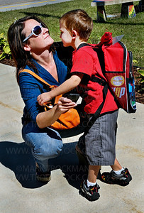 Student Alex Koeller, right, gets a hug and a kiss from his mom, Jean, on the first day of class for Plymouth Creek Elementary School's Kindergarteners Wednesday, Sept. 7, 2011.