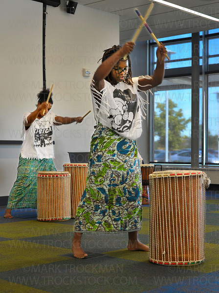 Yonci Jameson, right, 14, and her mother, Kenna Cottman, beat a rhythm during 'Global Folk: West African Drum and Dance' program Saturday, Sept. 15, at the Plymouth Library.  <br /> <br /> Cottman, and her son and daughter hosted this interactive program which included drumming, dancing, rhythm-making, and singing, free of charge.