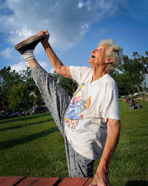 Neal Wilson shows off her flexibility in Mound Bay Park before the start of Music in the Park Thursday, June 24.  The 84 year old Mound resident and her husband Jack believe staying in shape contributes to their longevity and the success of their 60 year marriage.  They met during World War II where Jack flew planes for the Navy and she was in the Women's Army Auxiliary Corps.