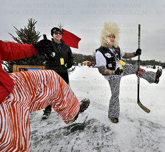 "White wigged Terry Krupich, right, of golf team 'Slicers, Hookers, and Booze,' celebrates his putt on frozen Wayzata Bay during the 29th annual Chilly Open Saturday, Feb. 9 on Lake Minnetonka.  The event is a unique frozen golf event to celebrate our ""chilly"" winter season."