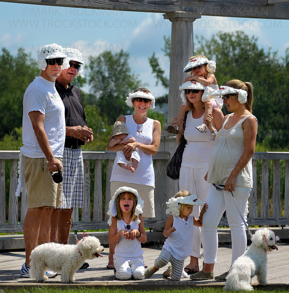The Dog & Owner Lookalike Contest winners gather on the lakeside deck in Mound's Harbor District Park during Westonka Dog Days Saturday, Aug, 13, 2011.  The winning team consists of two families, the Sampsons and the Madigans who wore white cotton ball hats and ears to mimic their two Bijans, Cleo and Sampson.  The prize for first place was a First Aid Kit... for dogs.