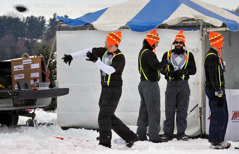 Calhoun Technologies employees wore bright caps and tuxedo look-a-like t-shirts while waiting their turn to throw a miniature football through a miniature hole during the 27th annual Chilly Open on Wayzata Bay Saturday, Feb. 12.