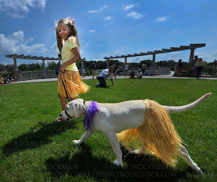 Baylee Poikonen, 10, and Zuzu the Yellow Lab, Mound, took second place in the Dog & Owner Lookalike Contest during Dog Days Westonka at Harbor District Park in Mound Saturday, Aug. 13, 2011.  The Lookalike Contest was one of eight scheduled events that included a Sleddog Seminar, a Cutest Puppy Contest and a nondenominational Animal Blessing in the grassy circle along the Andrews Sisters Trail.