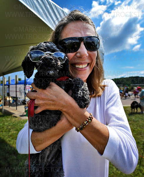 Ellie McKinley, 6, a black Cockapoo, sported cool sunglasses like her human, Mary McKinley, at Westonka Dog Days held Saturday, Aug, 13, in Harbor District Park in Mound.