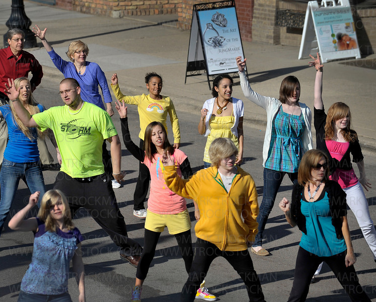 Christ Community Church members participate in an Easter Global Dance Sunday morning, April 24, in Excelsior.  <br /> <br /> Excelsior's Water Street was closed to traffic for a short time between 2nd and 3rd Streets to accommodate church members who participated in a four minute, choreographed dance that was repeated by church groups all over the world and will eventually be accessible by the public on YouTube.
