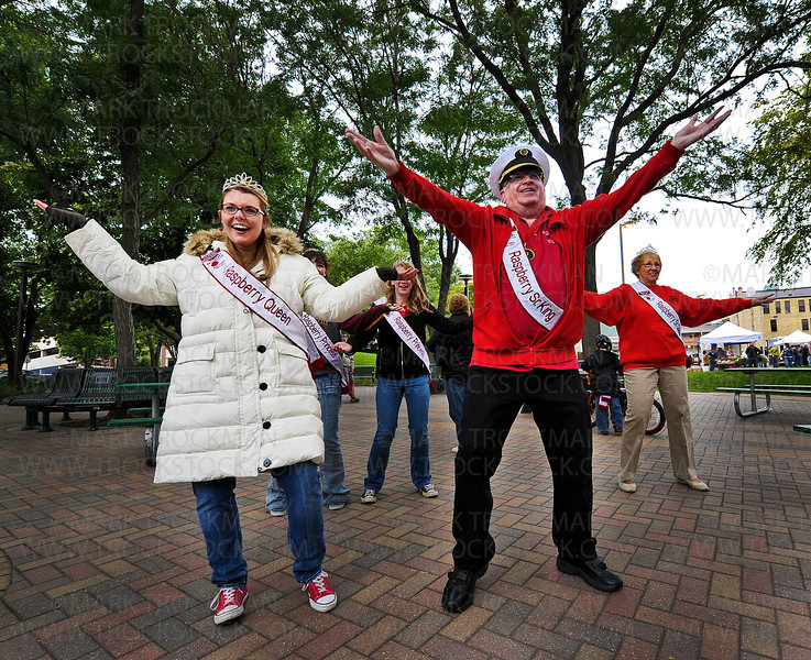Hopkins Raspberry Festival Royalty dance to the Zumba sounds led by Ridgedale YMCA group exercise instructor Melinda Thein in Downtown Park in Hopkins Saturday, Sept. 17, 2011.  Leading the Royal moves are Queen Karissa Mathiason, left, and Senior Ambassador Jim Gall.