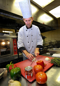 Old Log Theater head chef Chris Stark chops fresh vegetables in the dinner theater's kitchen for the evening Sunday, Nov. 9.