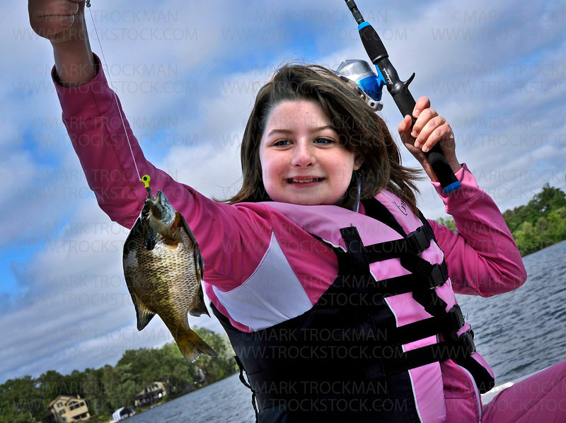 11 year old Alissa Post shows off a sunfish she caught Thursday, June 9, on St. Albans Bay on Lake Minnetonka in Excelsior.  About two dozen Hopkins School District students from under privileged living situations spent the day on the lake as part of the Cops and Kids Fishing Event sponsored by the Hopkins Police Department.