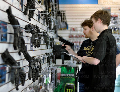 MN Pro Paintball's store manager, Robby Drake, right, talks shop with customer Tim Robertson, Shoreview, Wednesday, April 25, in the business's Minnetonka location.