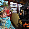 A Witch (Julie Englander), right, puts a spell on Booseum & Ghost Trolley passengers, left to right, Anna Peschong, 3, Luke Peschong, 1, and Grandma Jackie Peschong aboard a haunted trolley car in Excelsior Saturday, Oct. 26, 2012.