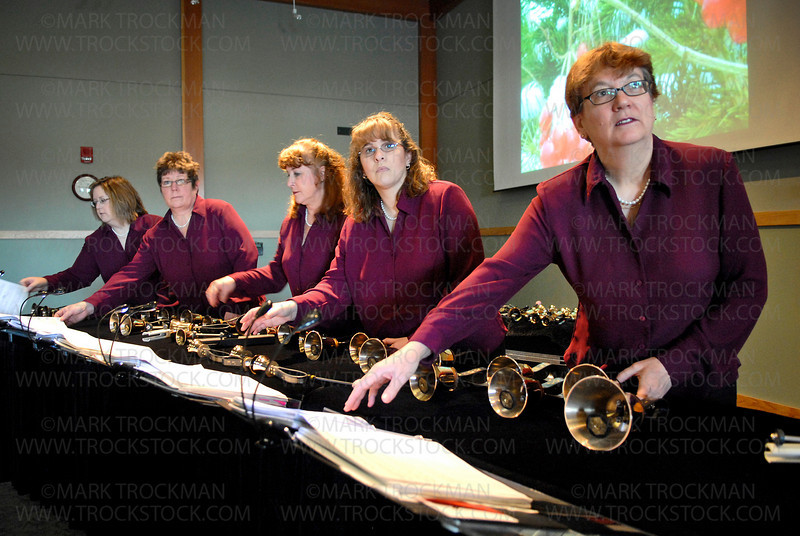 Twin Cities Bronze musicians prepare to perform before a packed house in McMillan Auditorium at the Minnesota Landscape Arboretum Sunday, Dec. 13, in Chaska.