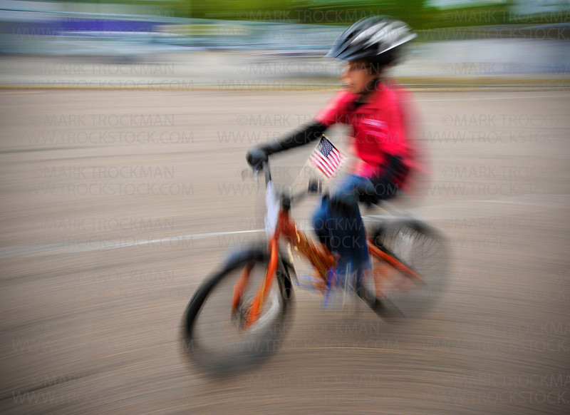 Raspberry Festival Junior King Adam Rothman, 8, negotiates the Hopkins Police Department's Bike Safety Course during Hopkins in Motion, held on a cool Saturday, Sept. 17, along Ninth Street in Hopkins.
