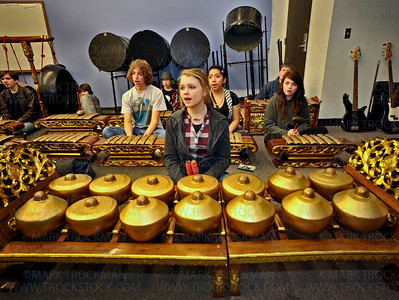 Randi Jo Pusch, center, and several classmates plays Gamelan Javanese instruments during a practice performance Thursday, Mar. 10, at the Main Street School in downtown Hopkins.