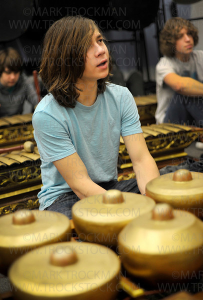 Micah Valentiner, sitting at an instrument called a Boang, answers a question posed by Gamelan Javanese instructor Joko Sutrisno during a practice performance Thursday, Mar. 10, at the Main Street School in downtown Hopkins.
