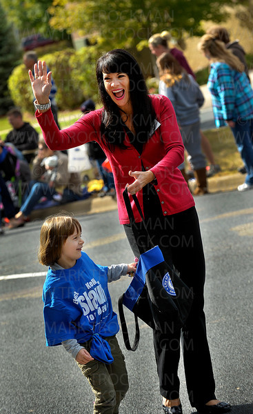 Plymouth Mayor Kelli Slavik waves to the crowd along Plymouth Boulevard Saturday, Sept. 24., during Plymouth on Parade, an annual Fall Festival in the West Metro city.