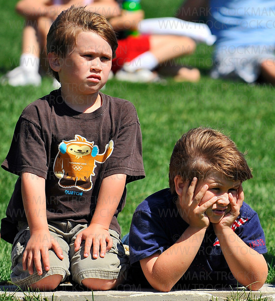 Jack Sparber, left, eight, and his younger brother Isaac, six, concentrate on Minnetonka Theater's production of Free to Be You and Me Thursday, June 17, at the Minnetonka Civic Center Campus.