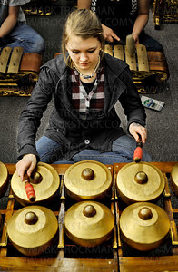 Randi Jo Pusch plays a Gamelan Javanese instrument called a Boang during a practice performance Thursday, Mar. 10, at the Main Street School in downtown Hopkins.