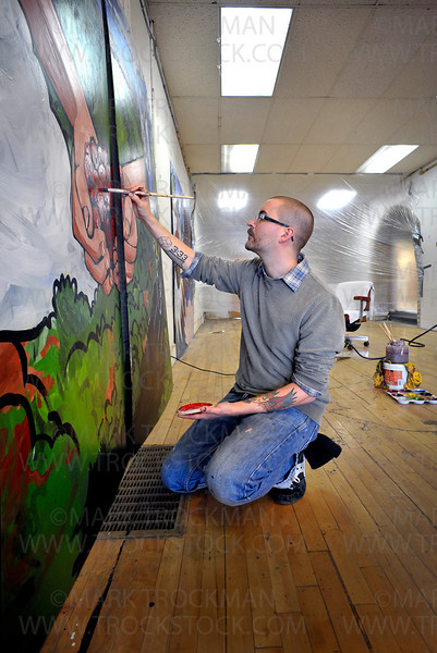 The city of Hopkins has hired artist Christopher Bowman, photographed Wednesday, Dec. 29, to paint a nine-panel mural to be placed in the storefront windows of the vacant business space at 812 Mainstreet.