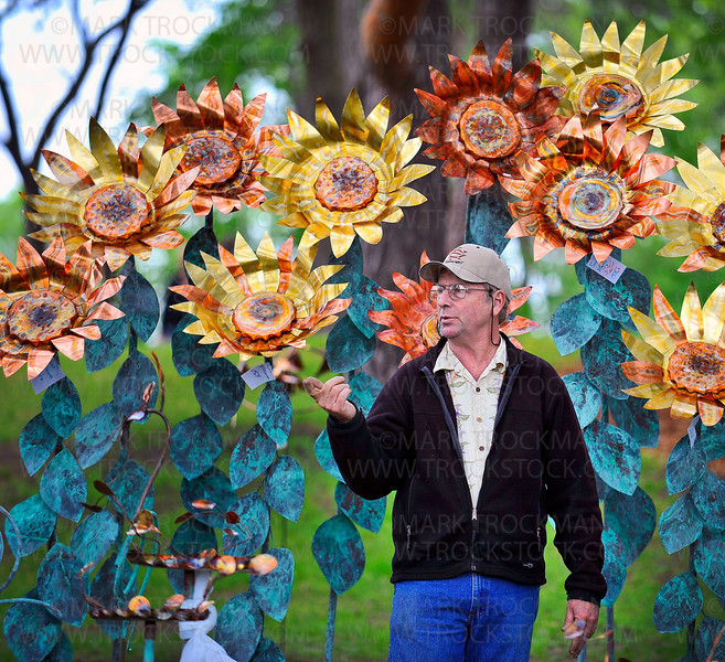 Big copper and brass flowers spring forth for artist Alexander Zaves at Art on the Lake in Excelsior Commons Sunday, June 13.  Zaves, who creates garden art, water fountains and Kinetic wind sculptures calls Santa Barbara, Calif. and Fergus Falls, Minn. home.