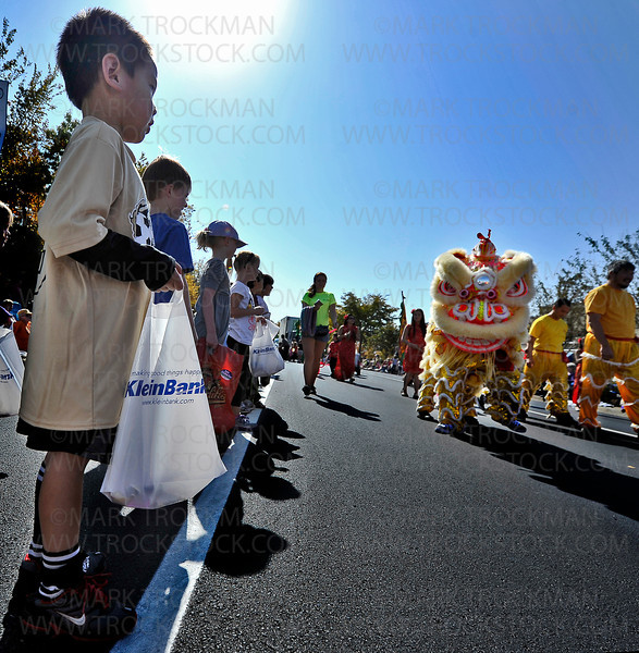 Here be dragons.  Colorful, fanciful creatures amble down Plymouth Blvd. during the annual Plymouth on Parade Festival, Saturday, Sept. 29, 2012.  The interesting beings walked with dancers and acrobats from the Ha Family Lion Dance Troupe.