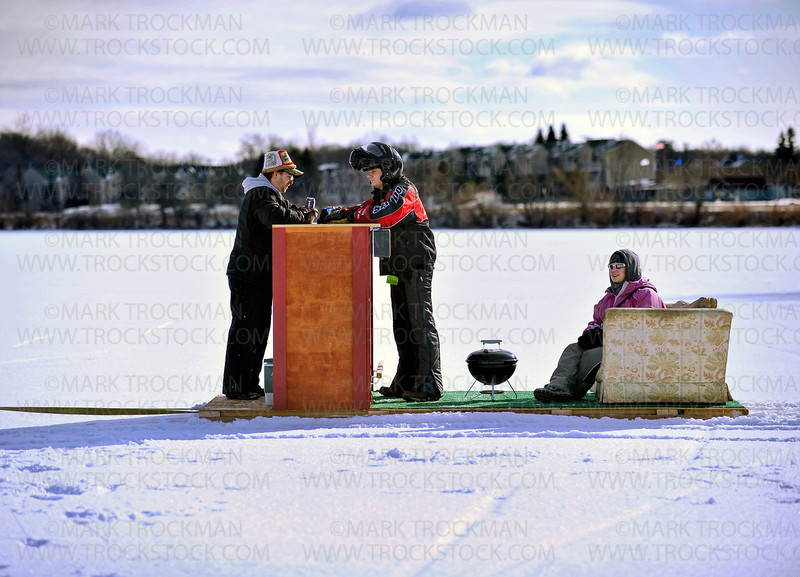 Three members of 'Dan's Depot Bar' are pulled across Long Lake during the Orono Lions 25th annual 'Snowball Open' Saturday, Jan. 28, at Nelson Park.  The 'bar's' patrons are (left to right) Dan Quinn, Daniel Murphy, Emily Quinn, and pulling the floating bar on his ATV is Daniel Murphy (not pictured).