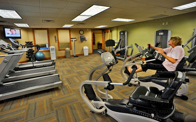 Louise Robertson, an 11 year employee of the facility, works out in the Wings Wellness Center in the newly expanded Lake Minnetonka Shores, Wednesday, July 6, in Spring Park.