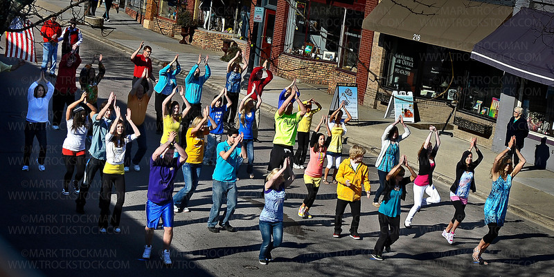 Christ Community Church members participate in an Easter Global Dance Sunday morning, April 24, in Excelsior.<br /> <br /> Excelsior's Water Street was closed to traffic for a short time between 2nd and 3rd Streets to accommodate church members who participated in a four minute, choreographed dance that was repeated by church groups all over the world and will eventually be accessible by the public on YouTube.