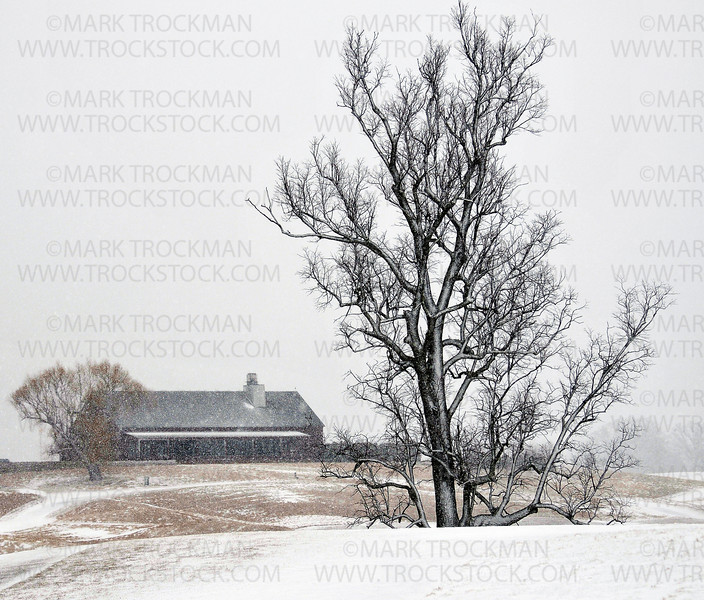 The Windsong Farm Golf Club club house seen from the fairway on the 18th hole during a fast moving snow squall Friday, Jan. 27, in Independence.